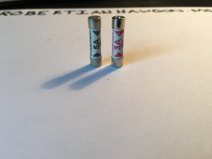 The two fuses standing upright.