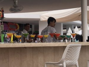 A line of cocktails at the poolside bar.
